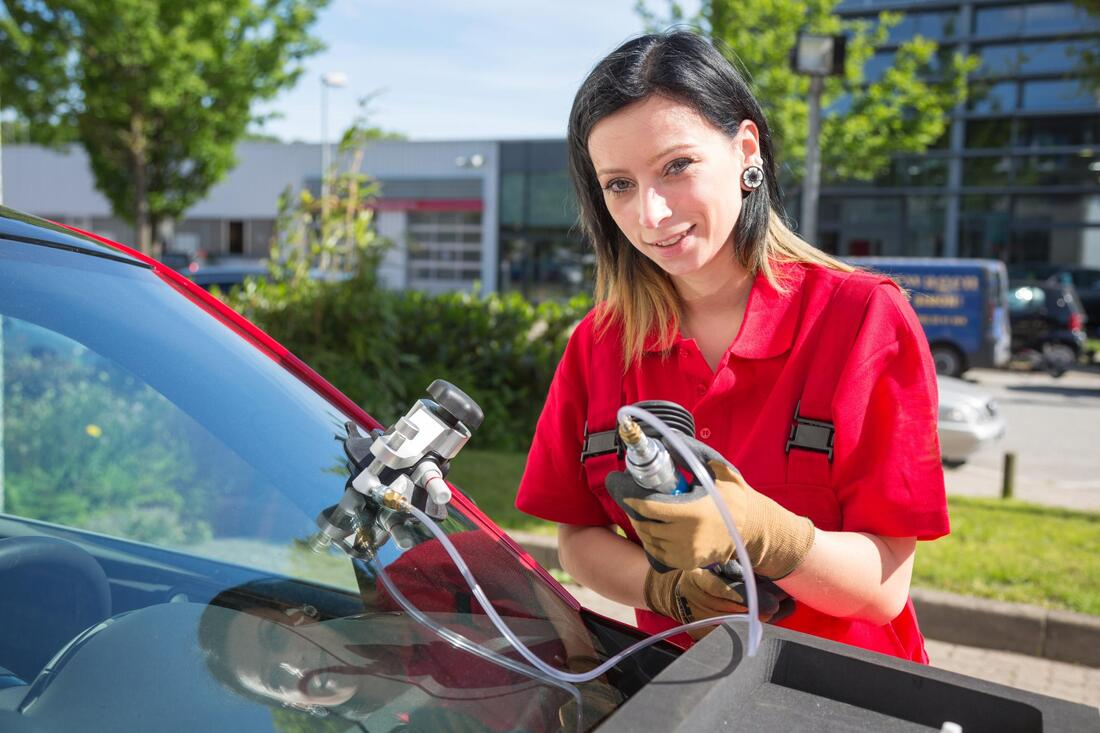 woman using tools for windshield